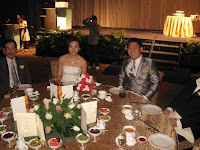An image of wedding couple Junn and Vanessa at their main table