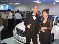 Singer and Pianist posing by the car