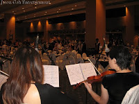 an image taken from behind the string quartet showing the guests that attended the wedding