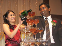 champagne pouring by the bridal couple