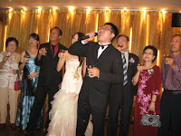 Chris, the bridegroom performing the toast or yam seh