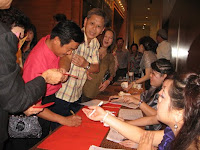 The hand over of Ang Pows at the registration counter