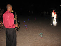 The saxophonist serenading Yen and Matt by the beach