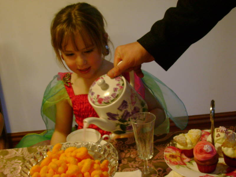 Fancy Nancy Party - getting served strawberry milk at the fancy tea party
