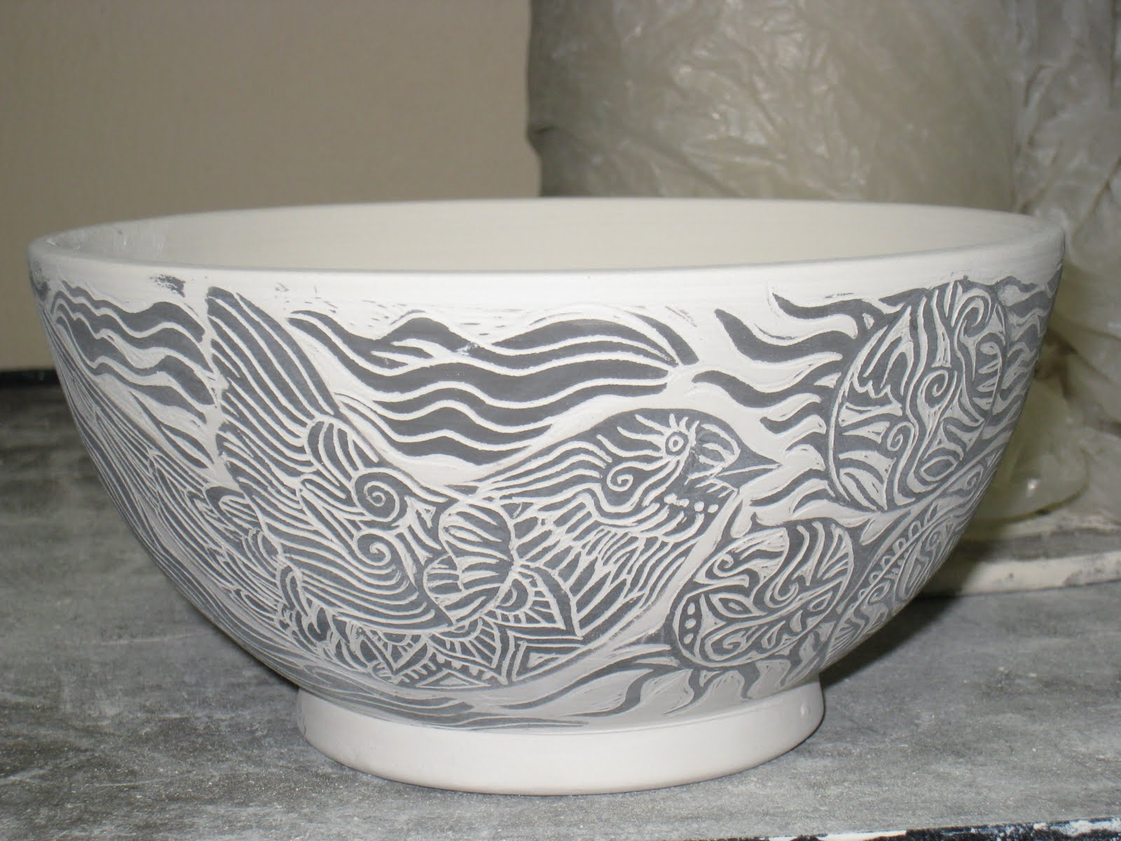 Randi martin kish ceramics carving designs into cups