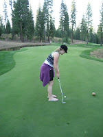 Image of woman putting on putting course at Martis Camp