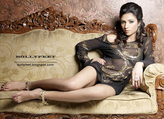 Sexy Indian Model on the couch barefoot