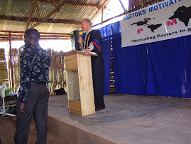 Alan speaking at Nexus Seminary Uganda first graduation 10/6/07