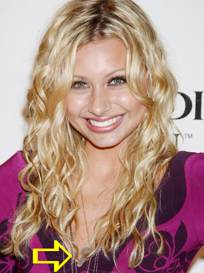 Aly Michalka wearing a Jenny Dayco necklace