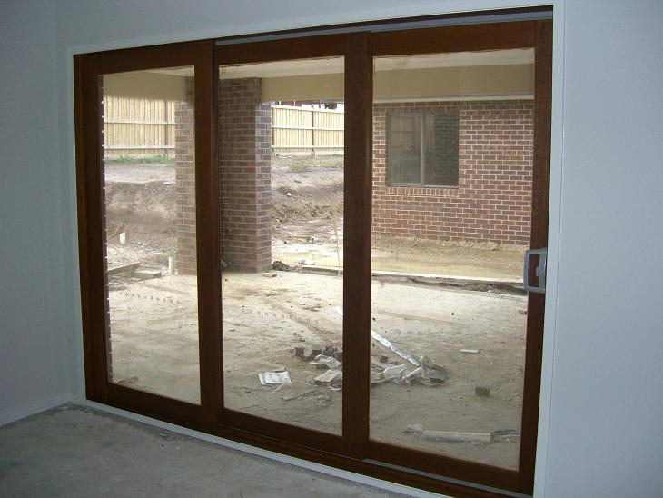 Stacker sliding doors have been stained. Ooooo now we just have to wait for that deck to be built... Might be a while! & Our Henley Voyager 383: Timber doors stained