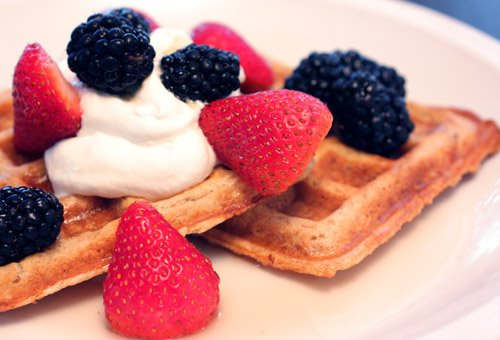 with raspberry whipped cream mixed berries lemon cream pie waffles