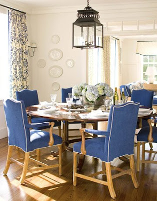 more inky blue upholstery on dining chairs via the floral drapes are fun too and notice how the designer tied the window treatments in - Blue And White Dining Chairs