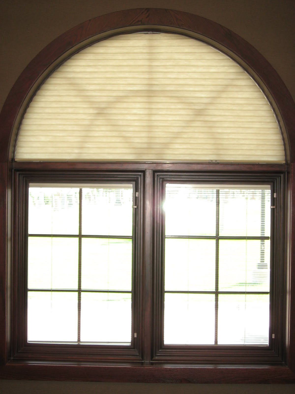 Window fashions duette honeycomb shades easy view arch for Curved windows