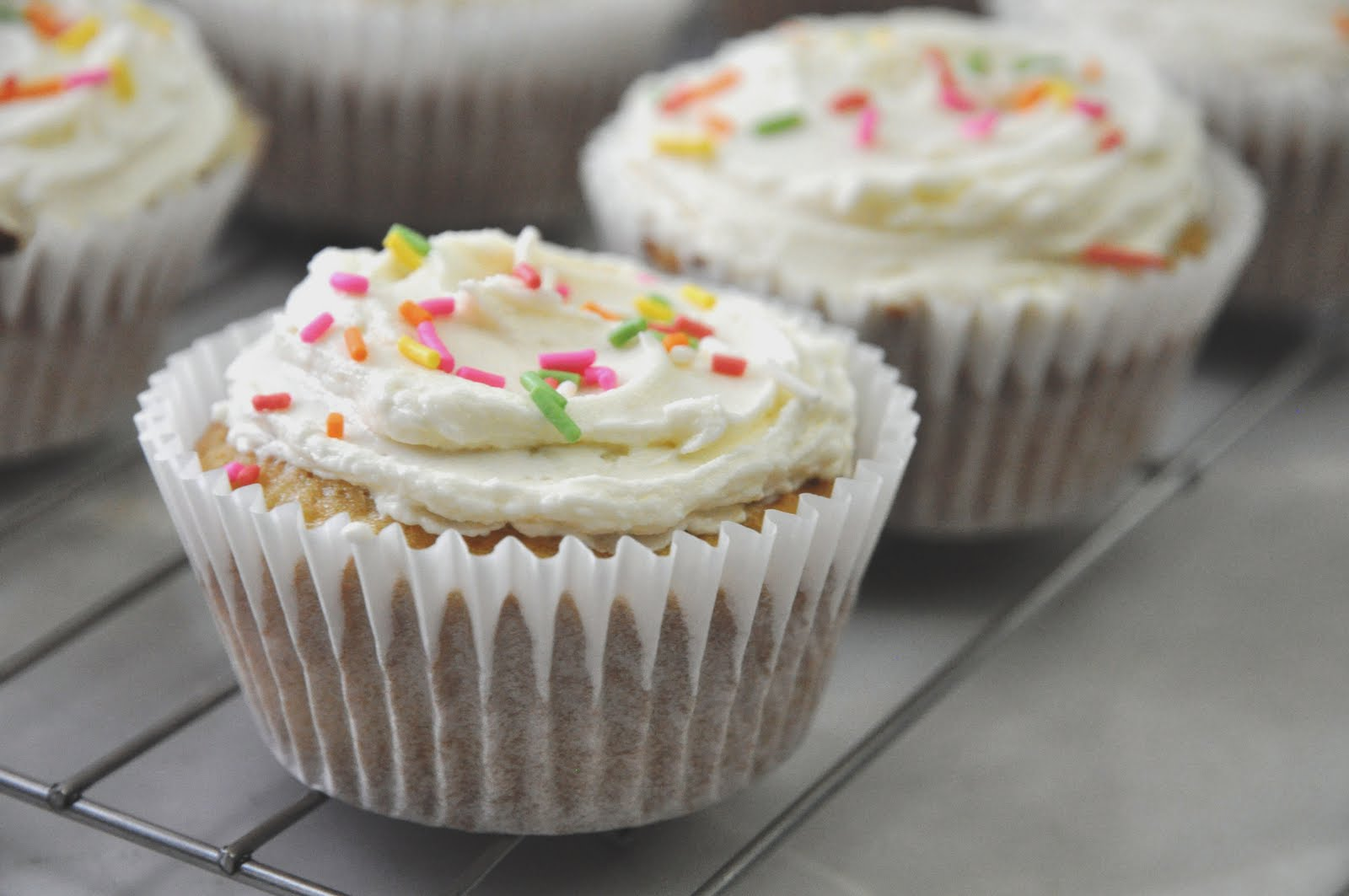 above) Vanilla Cupcakes with Vanilla Buttercream Frosting