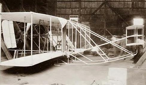 Wright Bros plane in hanger at Washington, DC 1908