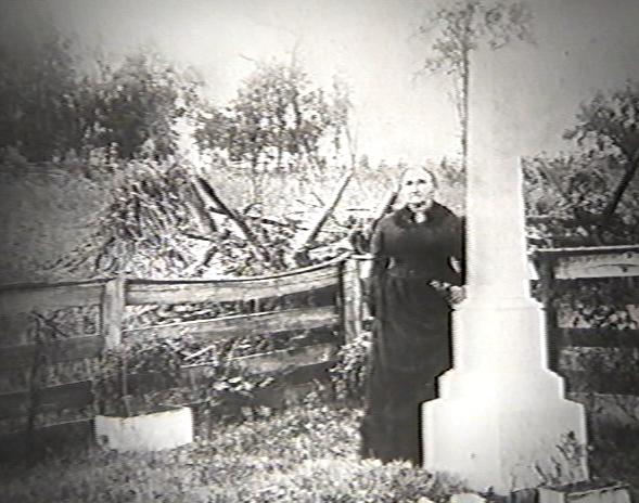 Jesse's mother by his first grave on the James farm