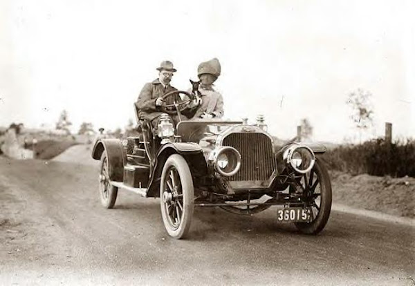 George G. Bain & Wife & dog driving. Undated photo
