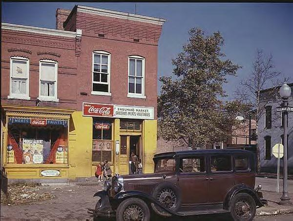 1930 Chevy in front of Shulman's market, Union St. S.W., Washington DC 1941