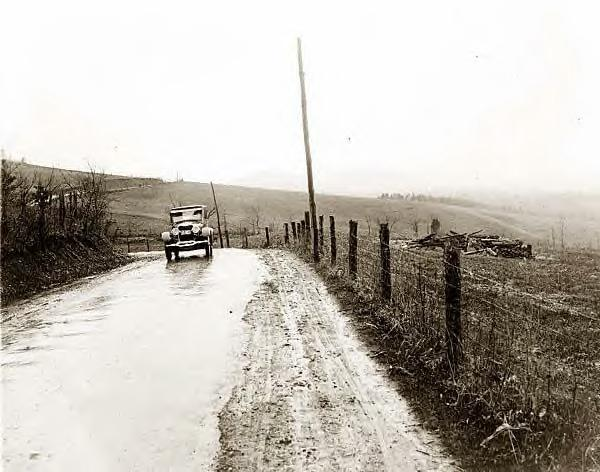 Car on wet road, Shenandoah Park, Va., 1925