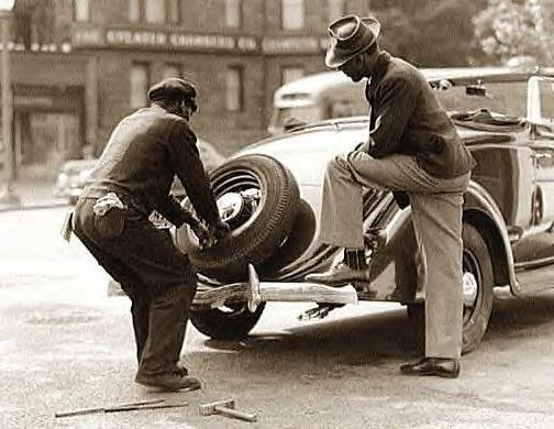 Changing tire. 1942