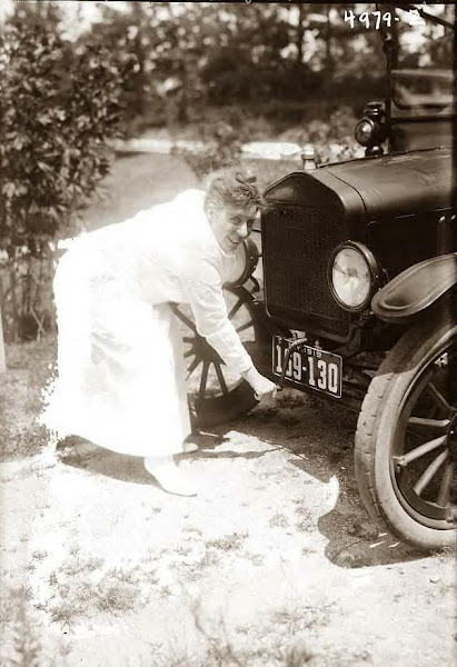 Ada Jones crank starting her Model T Ford, 1919