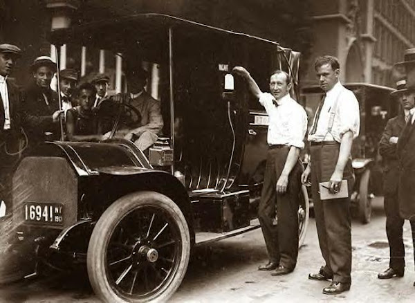 Inspector Walsh condemning NYC taxicab. 1913