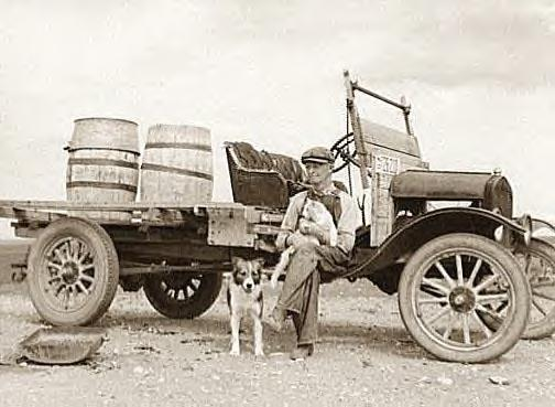 Herman Gerling with truck & water barrels, Wheelock, N.D., 1937