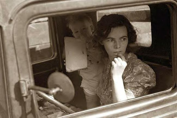 Farmer's wife in truck, Oskaloosas, Kansas, 1938
