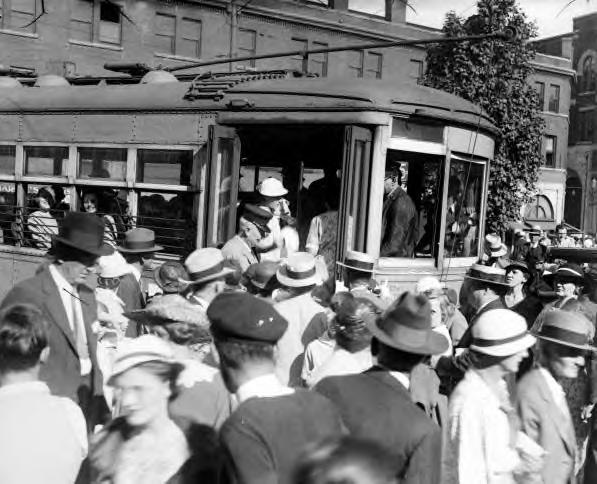 Crowd getting on a streetcar. Asheville, NC. 1928