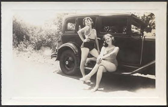 Two young ladies coming from prayer meeting. 1930 Chevrolet sedan