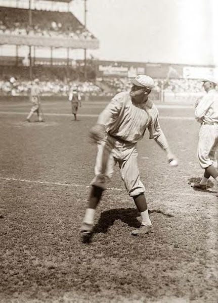 Babe Ruth throwing to baseman