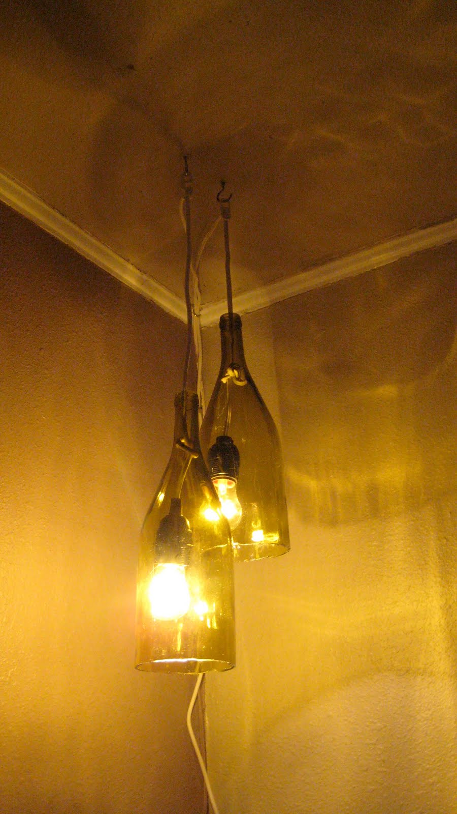 Making Wine Bottle Lights Remodelaholic How To Make A Glass Wine Bottle Pendant Light Diy