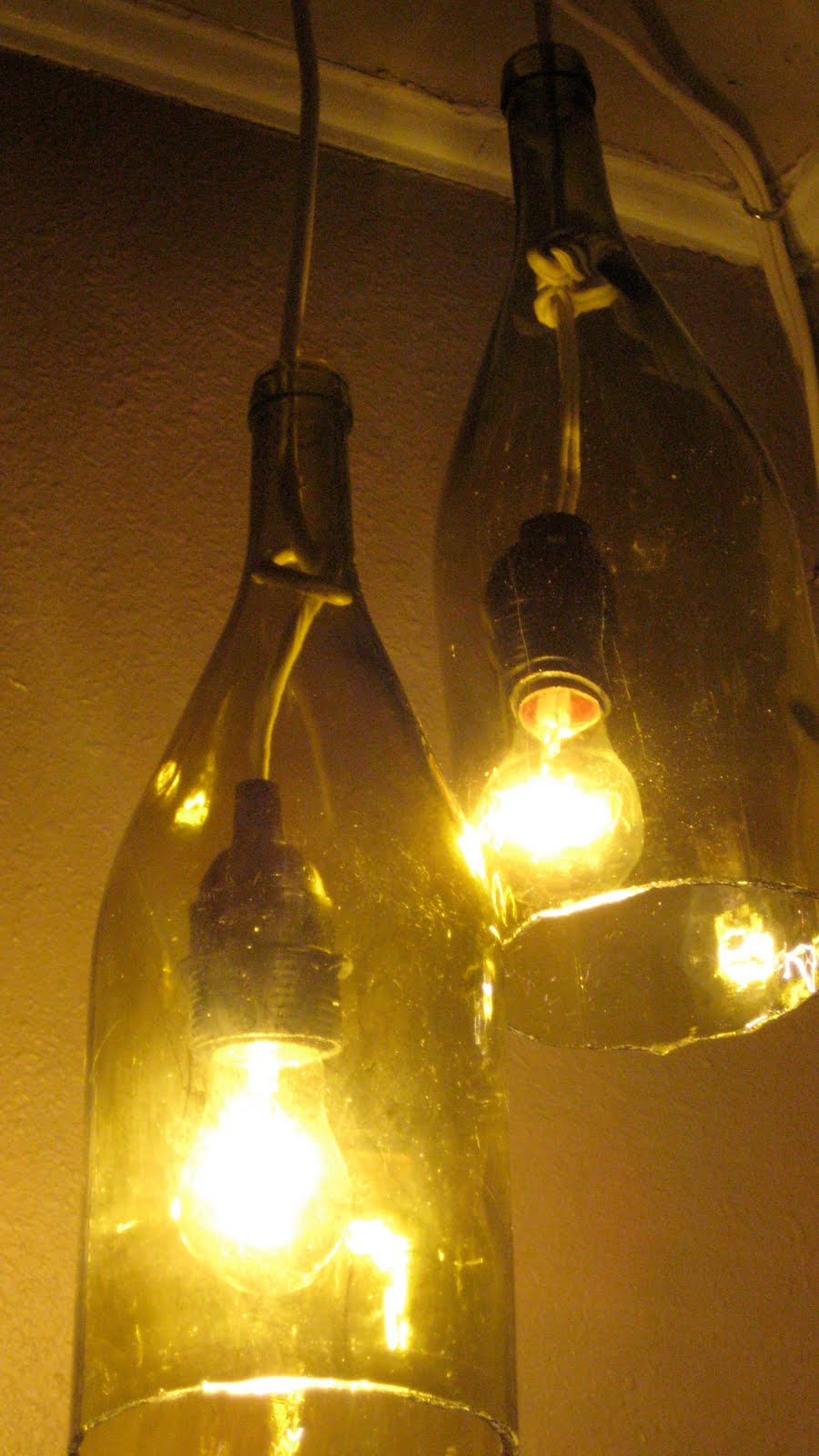 Remodelaholic how to make a glass wine bottle pendant for Glass bottles with lights in them