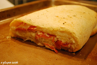 http://www.aglimpseinsideblog.com/2010/11/tasty-tuesday-pizza-roll-up.html