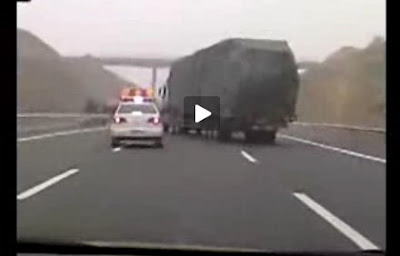 to pull over a large truck on a chinese highway but the trucker