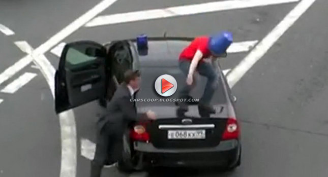 Russia VIP Lights Bucket Head Jumps Russian VIP Car Over Illegal Use of Police Like Light to Cut Through Traffic Photos Videos