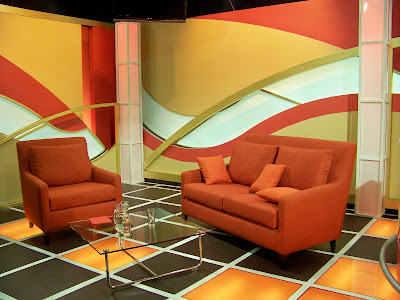 Pattern Incorporated Into The Set Design Wavey Curve Distribution Playing Out In Back Panels Orange Bottom Lit Floor Panel Insets