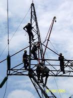 menukar tension insulator y tower