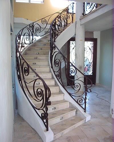 Forja y herreria especializada de monterrey pasamanos y for Fotos de escaleras de herreria
