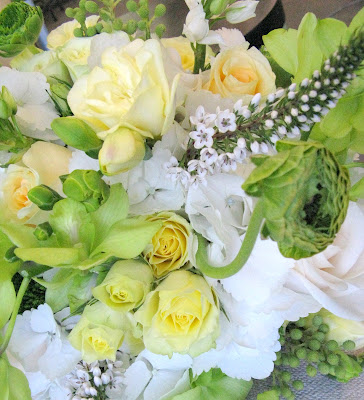 spray roses pale yellow freesia and light green dendrobium orchids