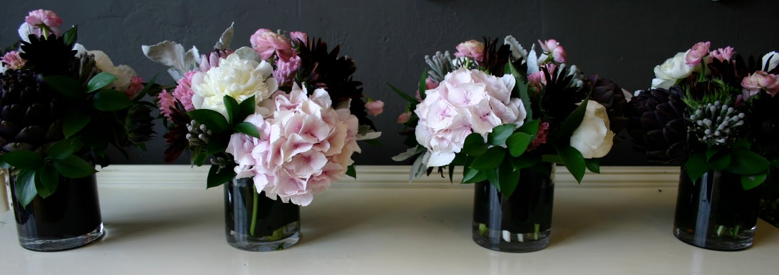 Pretty in pinkd black and grey and white bows and arrows dhlflorist Choice Image