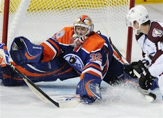 Mathieu Garon makes one of his 32 saves against the Colorado Avalanche