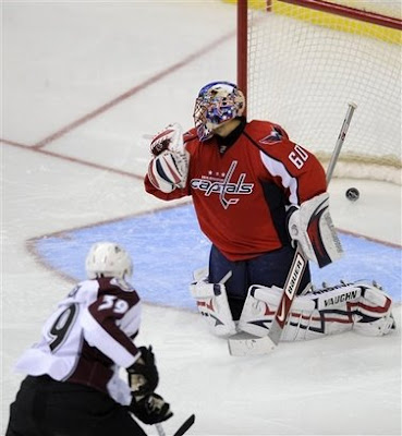 Jose Theodore looks over his shoulder after giving up a goal to Tyler Arnason of the colorado  Avalanche
