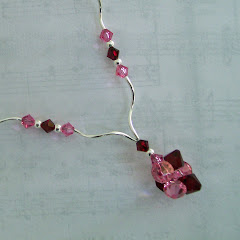 Rose and Siam Crystals and Swirls Necklace