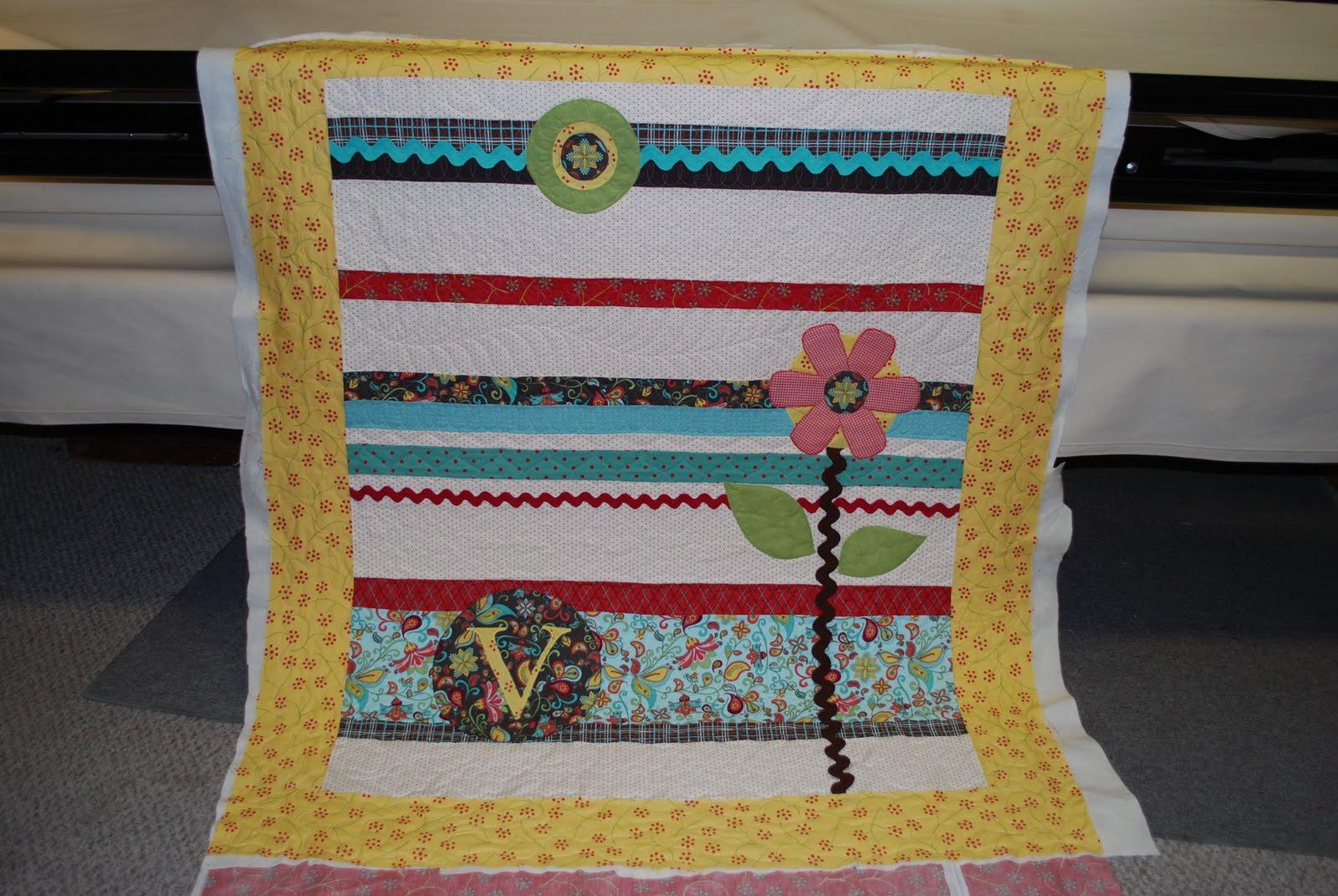 Designs by laura jo flower applique strippy quilt