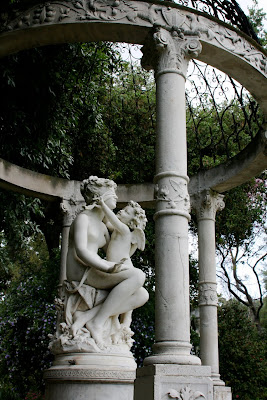 Cherub blindfolds woman statue Huntington Gardens