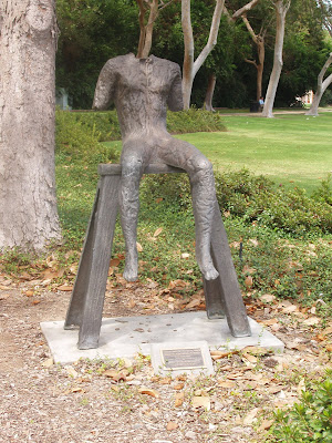 Beverly Gardens Park sculpture - Sitting figure on a short bench