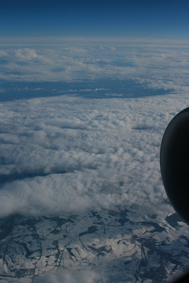 Snowy Manchester from above the clouds
