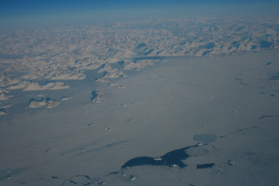 Coast of Greenland above the clouds