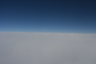 Flying to London above the clouds